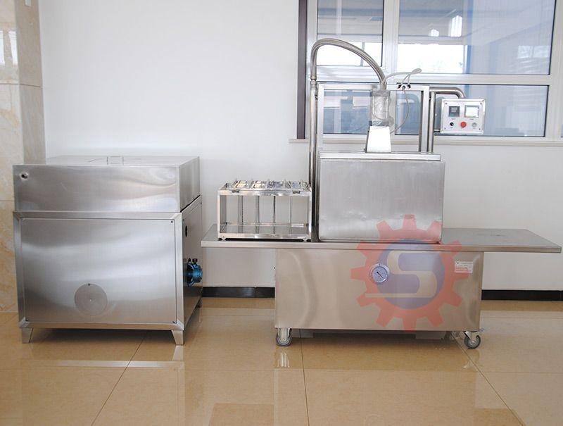 Vertical hot drawn vacuum sealing macine